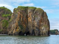 Россия. Камчатка. Rocks with caves and grottoes in Avacha Bay of the Pacific Ocean. The coast of Kamchatka. Фото yykkaa -Depositphotos