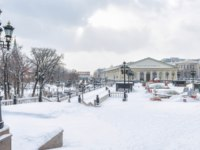 Россия. Москва. Александровский сад. Manezhnaya Square in the winter. Panoramic view of central Moscow during snowfall. Фото scaliger - Depositphotos