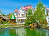 The tiny garden with a pond among the mansions, museums and workshops of Izmailovsky Kremlin, the Russian style cultural, art and entertainment center, Moscow