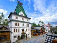 Izmailovsky Kremlin inner yard. White stone manor. Russian traditional classic wooden and stone architecture buildings. Classic white stone empirial palace Russian