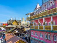 The carved timbered and colorful painted mansions in Izmailovsky Market represent the different periods of architecture in Russia, Moscow. Фото efesenko-Deposit
