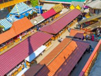 All the stalls of Izmailovsky Market are hidden under the red roofs, protecting from sun, rain and snowin Moscow. Фото efesenko-Depositphotos