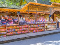 The carved stalls with wide range of traditional wooden painted matryoshka dolls, the world known symbol of the country in Moscow. Фото efesenko-Depositphotos