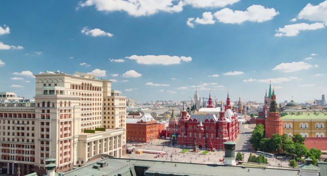 Panorama to Manezh Square, Hotel Moscow, historical Museum and Kremlin timelapse at cloudy summer day from top in Moscow, Russia. Фото neiezhmakov-Deposit