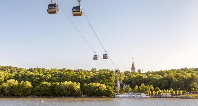 Воробьевы горы. Scenic view of the cable car between Sparrow Hills and Luzhniki Stadium in Moscow. Cableway cabins hang in the sky above Moskva River in Moscow