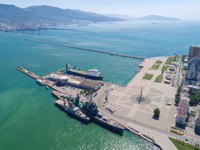 Россия. Панорама Новороссийска. Aerial view of the Novorossiysk port and its entrance, the marine station cruiser Mikhail Kutuzov. Фото mike_laptev-Dep