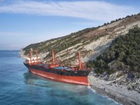 Россия. Кабардинка. Выброшенный сухогруз Rio. The ship called Rio ran aground after a storm in the black sea. Aerial view. Фото IvanVislov - Depositphotos