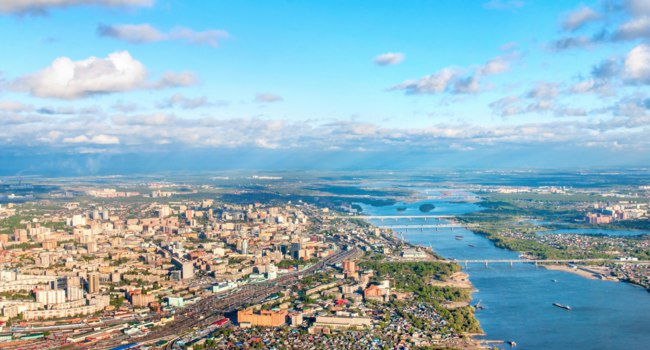 Россия. Панорама Новосибирска. Novosibirsk aerial view and river Ob. Фото Elf+11 - Depositphotos
