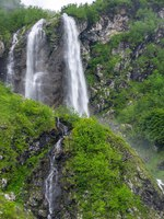 Россия. Сочи. Курорт Красная поляна. View of the waterfall in Caucasian mountains in Krasnodar Krai, Russia. Фото gumbao - Depositphotos