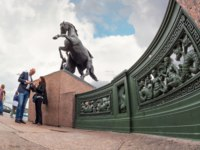 Россия. Санкт-Петербург. Аничков мост. Horse holding man sculpture by Peter Clodt in 1841, Anichkov Bridge in Saint Petersburg. Фото Sergieiev - Depositphotos