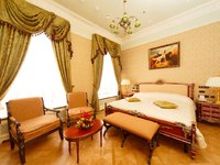 Россия. Санкт-Петербург. Интерьер Талион Империал отеля. Taleon Imperial Hotel St. Petersburg. Executive Suite bedroom