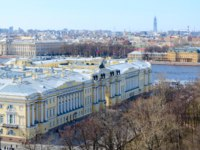 View from colonnade of St. Isaac's Cathedral on former Senate and Synod building and Neva embankment in historical center of St. Petersburg. Фото Olga355-Deposit