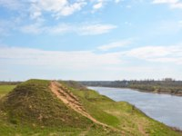 Россия. Ленинградская область. Старая Ладога. Volkhov river valley with Burial mound. Staraya Ladoga. Russia. Фото LehaKoK - Depositphotos