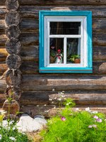 Mandrogi, Russia , Karelia Region, , a window of an old wooden house of the village on the Svir river bank. Фото giuseppemasci.me.com-Depositphotos