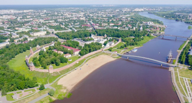Россия. Панорама Великого Новгорода. Veliky Novgorod. Novgorod Kremlin (Detinets), Volkhov River. Flight over the city, From Drone. Фото MaykovNikita - Deposit
