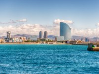 Испания. Каталония. Барселона. View of the waterfront from the port, Barcelona, Catalonia, Spain. Фото marcorubino - Depositphotos