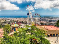 Испания. Каталония. Барселона. Aerial view over the Tibidabo Amusement Park, Barcelona, Catalonia, Spain. Фото marcorubino - Depositphotos