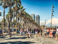 Испания. Каталония. Барселона. Walking on the promenade of Barceloneta beach, Barcelona, Catalonia, Spain. Фото marcorubino - Depositphotos