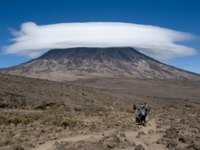 A group of porters passing through The saddle area on Rongai Route, Kilimanjaro. Фото mountaintreks - Depositphotos