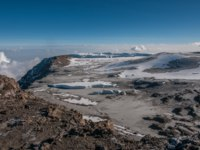 Looking down towards the Western Breach and the icefields of Kilimanjaro. Фото mountaintreks - Depositphotos