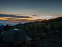 Танзания. Восхождение на гору Килиманджаро. Sunrise at Kikelelwa Campsite on Kilimanjaro, Rongai route. Фото mountaintreks - Depositphotos