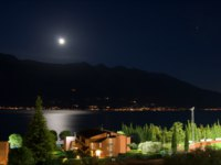 Италия. Озеро Гарда. Lake Garda at night, moon shining over Monte Baldo, Limone, Italy. Фото maigi.com - Depositphotos