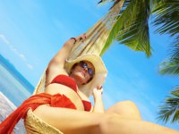 Мальдивы. Maldives. View of nice woman lounging in hammock in tropical environment. Фото ersler - Depositphotos