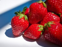 Some fresh strawberry isolated on white background. Фото Tomasz Tulik - Depositphotos