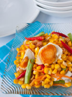 Thaifood, corn salad with salted egg spicy-sour dressing. Фото Piyachok - Depositphotos