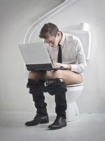 Young Businessman on the Toilet. Фото Michele Piacquadio - Depositphotos