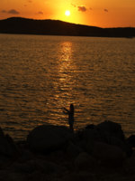 Италия. Сардиния. Fishing on soft sunset on Sardinia. Фото Leonid Katsyka - Depositphotos