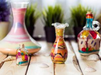 Клуб путешествий Павла Аксенова. Иордания. Амман. Decorative Glass Bottles with Colored Sand Inside and Shapes of Desert and Camels. Jordan. Фото Toyechkina - Depositphotos