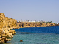 Египет. Синай. Шарм-эль-Шейх. Panorama of the beach with coral reef at sunny day at Sharm el Sheikh, Egypt. Фото Marina113 - Depositphotos