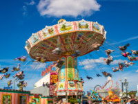 Германия. Бавария. Carousel in motion blur at at the folk festival of the world - the Oktoberfest in Munich. Фото JimmyR - Depositphotos