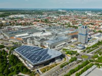 Германия. Бавария. Мюнхен. Aerial view of BMW Museum and BWM Welt and Munich in Munich, Bavaria, Germany. Фото D_Rukhlenko - Depositphotos