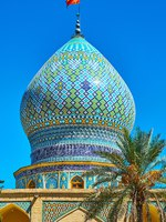 The bulbous dome of medieval Ali Ibn Hamzeh Holy Shrine, decorated with tile geometric patterns and carved details, Shiraz, Iran. Фото efesenko - Depositphotos