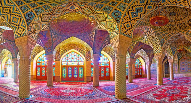 Panorama of the winter prayer hall of the Pink mosque with numerous carved columns, stained glass windows and tiled vault in Shiraz. Фото efesenko-Deposit