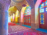 Иран. Шираз. Мечеть Насир оль-Мольк. The scenic stained glass windows in Nasir Ol-Molk mosque provide the lights to the prayer hall in Shiraz. Фото efesenko-Deposit