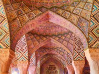Иран. Шираз. Мечеть Насир оль-Мольк. Fabulous view of vault ceiling covered colorful mosaic inside the Nasir al-Mulk Mosque. Shiraz. Фото efired-Deposit