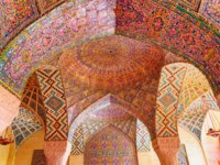 Иран. Шираз. Мечеть Насир оль-Мольк. Gorgeous view of vault ceiling covered colorful mosaic inside the Nasir al-Mulk Mosque. Shiraz. Фото efired-Deposit