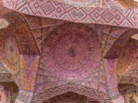 Ceiling in the praying room of the beautiful Nasir Al-Mulk Mosque or Pink Mosque a traditional mosque located in Goad-e-Araban place in Shiraz. Фото dbajurin-Deposit