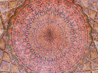 Иран. Шираз. Мечеть Насир оль-Мольк. Awesome view of vault ceiling covered colorful mosaic inside the Nasir al-Mulk Mosque. Shiraz. Фото efired-Deposit
