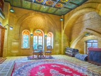 Иран. Рынки Шираза. The medieval hall of carpet market with relief brick walls, ornate ceiling, stained-glass windows, and Persian rugs in Shiraz. Фото efesenko - Deposit