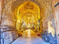 Иран. Шираз. Рынок Вакиль. The historic building of Vakil Bazaar, brick walls are decorated with geometric tiled patterns in Shiraz. Фото efesenko - Depositphotos