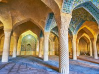 Иран. Шираз. Мечеть Вакиль. The summer prayer hall (shabestan) of Vakil Mosque is decorated with beautiful carved columns, tiled decors Shiraz. Фото efesenko-Deposit