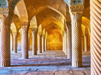 Иран. Шираз. Мечеть Вакиль. The scenic stone columns in Vakil Mosque are covered with carved pattern in Shiraz. Фото efesenko - Depositphotos