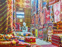 Interior of traditional carpet store in Vakil Bazaar - the kilims and rugs hang on the walls and lie in heaps on the benches in Shiraz. Фото efesenko - Depositphotos