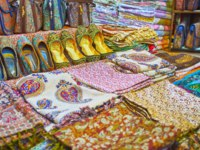 The wide range of traditional textile bags, slippers and scarfs, decorated with colorful prints, embroidery, and lurex, Vakil Bazaar, Shiraz, Iran. Фото efesenko - Deposit