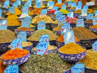 Vakil Bazaar is best place to choose some local spices or herbs in one of the multiple stalls with large showcase and wide variety, Shiraz, Iran. Фото efesenko-Depositphotos