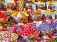 The counter of the spice store in Vakil Bazaar with large amount of bowls with spices, herbs, dried flowers and berries, Shiraz, Iran. Фото efesenko - Depositphotos